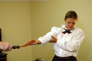 Jennifer Gets Her Hands And Bottom Spanked - image4