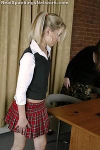 Strapped For Short Skirt - image4
